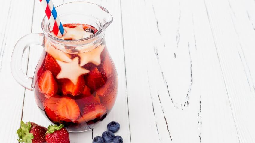 6 Red, White and Blue Batch Cocktails for Under $12, White and Blue Lemonade or Sangria. Patriotic drink cocktail wit, blueberry and apple for 4th of July party, red