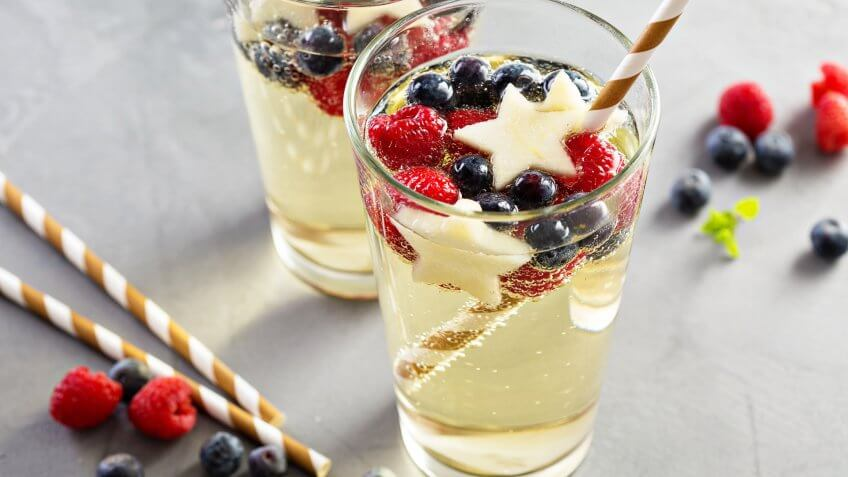6 Red, White and Blue Batch Cocktails for Under $12, blue and white sangria with sparkling wine, red