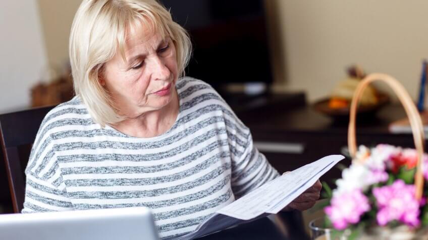 senior-woman-reviewing-earnings-record