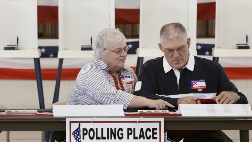 senior volunteers at polling place