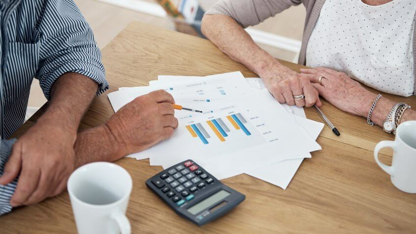 Cropped shot of a senior couple reviewing their financial investmentshttp://195.