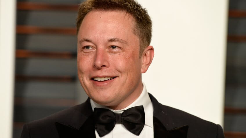 Elon Musk in black suite