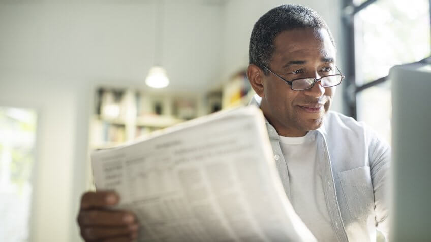 senior adult checking news