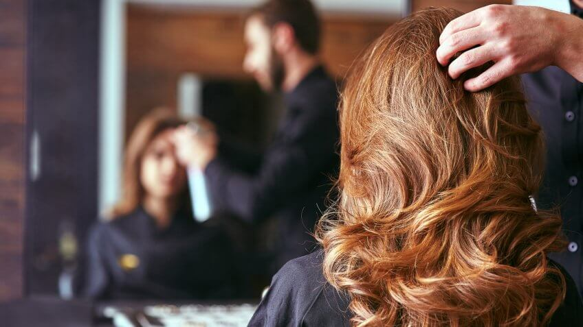 22 Industries That Pay Less (and More) Than They Did 10 Years Ag, Women's haircut. hairdresser, beauty salon