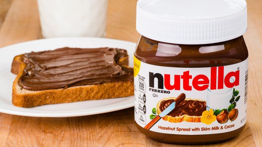 2014: Jar of Nutella, ATLANTA - APRIL 23, Things that are always cheaper at Costco, toast with Nutella spread and milk to drink.