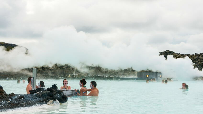 Reykjavik, Iceland - August 27, 2010: People apply silica mud to their skin while bathing in the Blue Lagoon, a geothermal spa in the south near the capitol, a popular tourist attraction.
