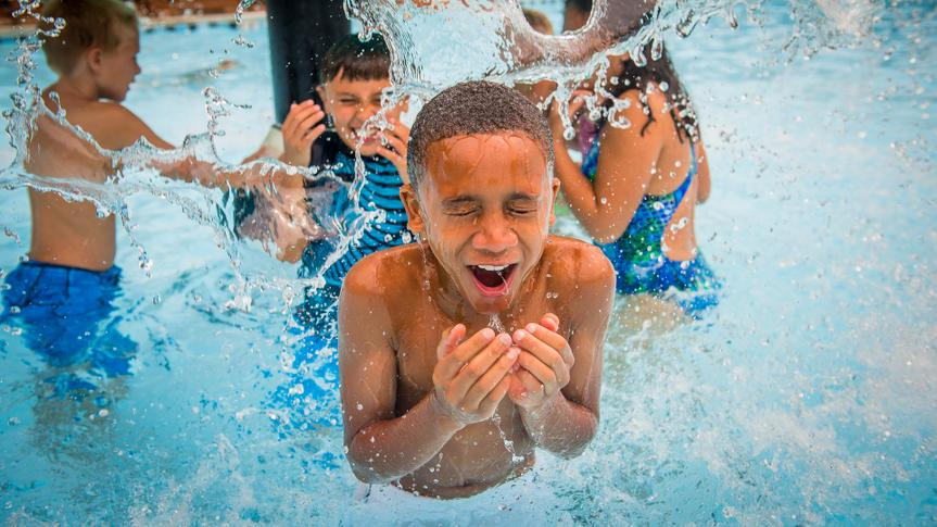 Children splash and play in the waters of Rock ÔNÕ Roll Island at Water Country USA¨.