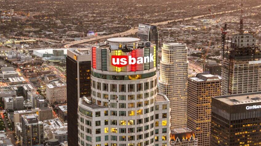 Los Angeles, California, USA - March 23, 2016:  Aerial view of the Us Bank Tower and sign in the Los Angeles downtown, Is visible also an helicopter flying around the tower.