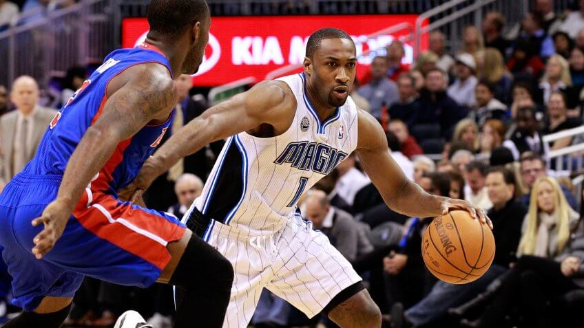 ORLANDO, FL - JANUARY 24:  Gilbert Arenas #1 of the Orlando Magic drives against Rodney Stuckey #3 of the Detroit Pistons during the game at Amway Arena on January 24, 2011 in Orlando, Florida.