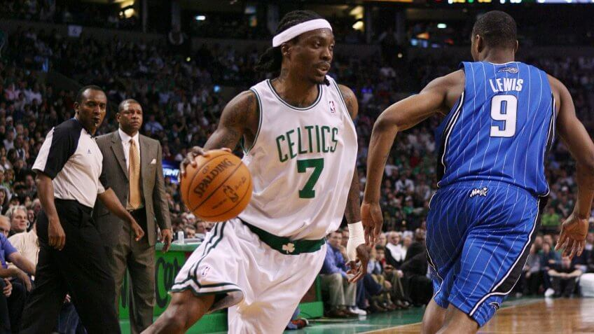 BOSTON - NOVEMBER 20: Marquis Daniels #7 of the Boston Celtics drives to the basket around Rashard Lewis #9 of the Orlando Magic during the game on November 20, 2009 at the TD Garden in Boston, Massachusetts.