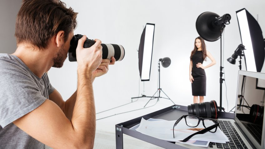 96 Money-Making Skills You Can Learn in Less Than a Year, Photographer shooting model in studio with softboxes