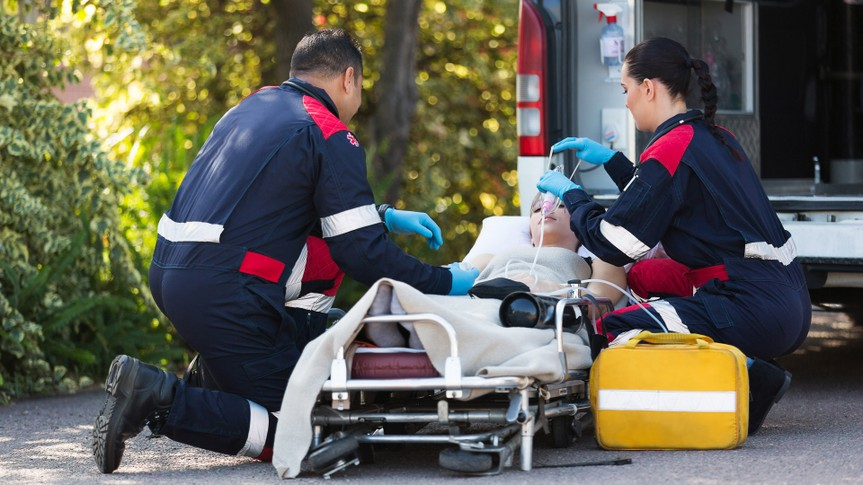96 Money-Making Skills You Can Learn in Less Than a Year, team of emergency medical staff rescuing patient