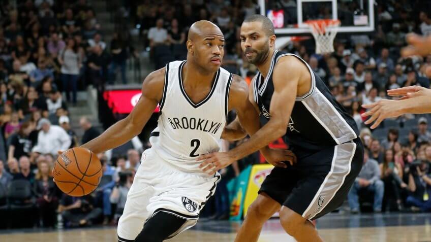 SAN ANTONIO, TX - OCTOBER 30: Jarrett Jack #2 of the Brooklyn Nets drives around Tony Parker #9 of the San Antonio Spurs at the AT&T Center on October 30, 2015 in San Antonio, Texas.
