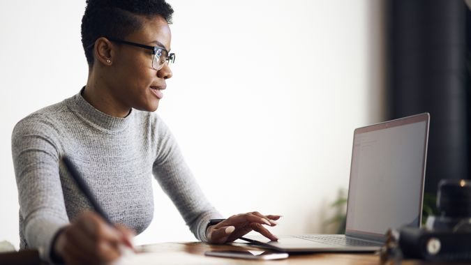 96 Money-Making Skills You Can Learn in Less Than a Year, Young afro american female executive filling in application on o