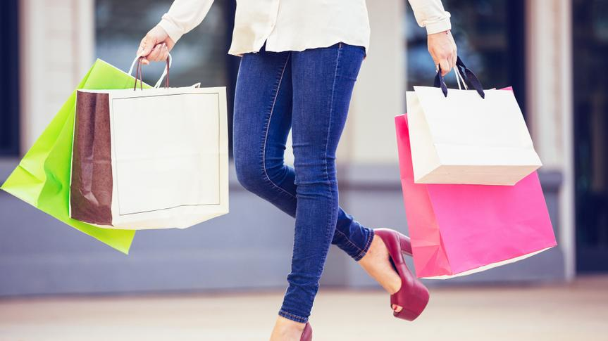Attractive young woman shopping at the mall, The Best and Worst Things to Buy in August 2017