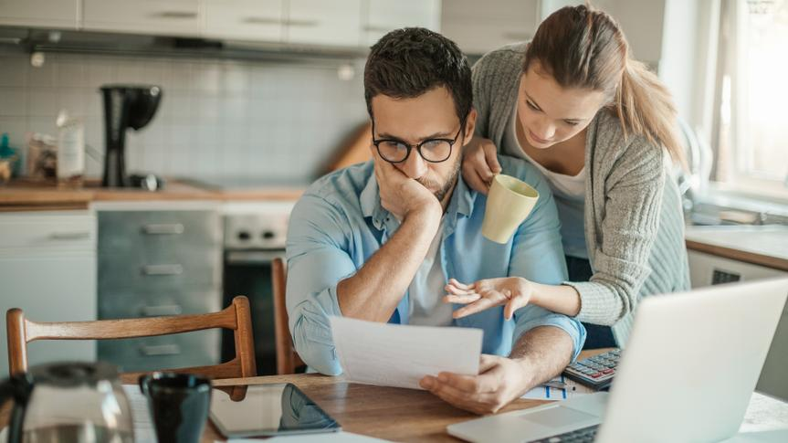 Photo of a young couple going through financial problems.
