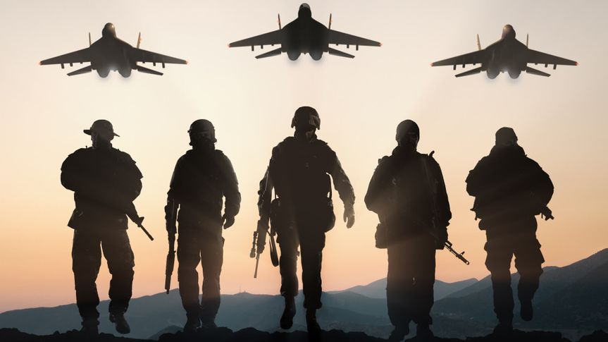 Military silhouettes of soldiers and airforce against the backdrop of sunset sky.