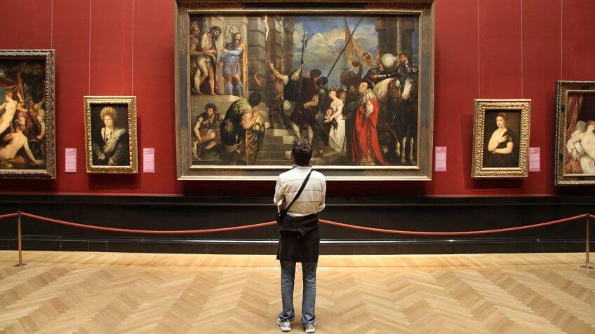 VIENNA, AUSTRIA - SEPTEMBER 8, 2011: Tourist admires art in Museum of Art History in Vienna.