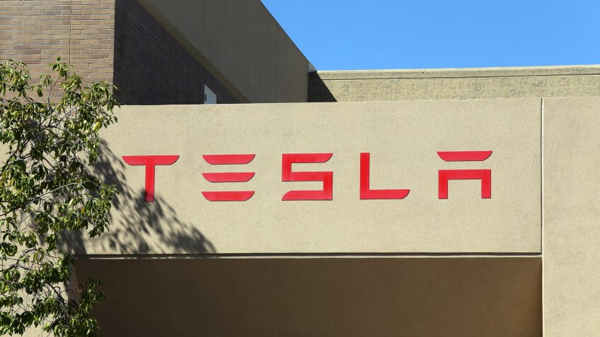 2014. Tesla Motors is an American company that designs, CA - MARCH 18: The Tesla Motors World Headquarters located in Pa, PALO ALTO, manufactures and sells electric cars.