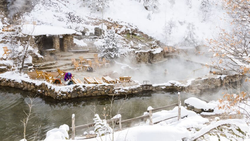 Strawberry Hot Springs surrounded by winter forest.
