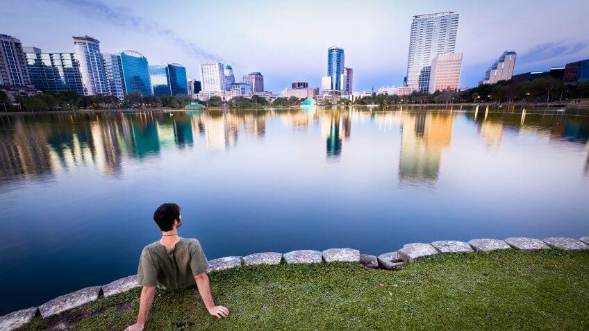 Man staring at the cityscape of Orlando, Florida, USA.