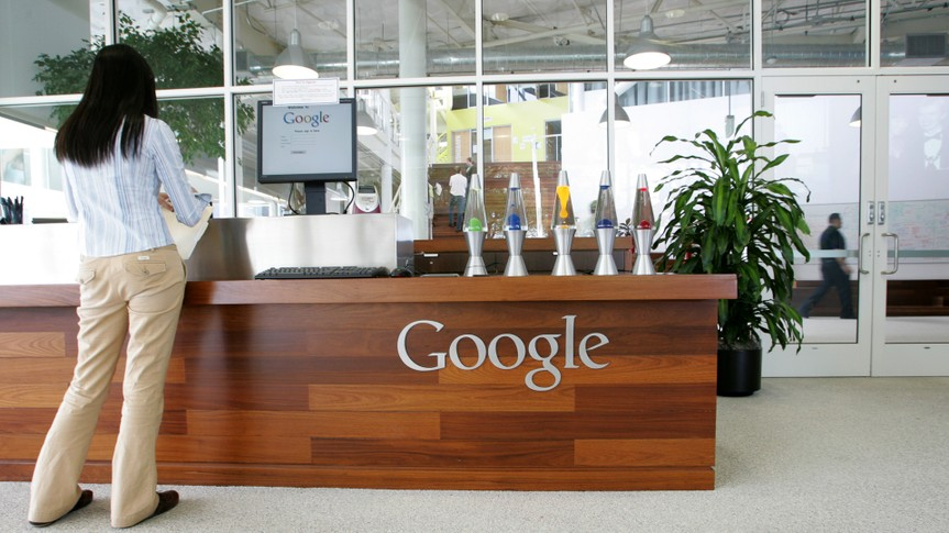 MOUNTAIN VIEW, CA - MAY 11:  A Google employee stands in a lobby at the Googleplex May 11, 2006 in Mountain View, California.