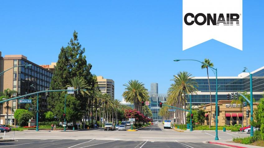 Anaheim, United States - September 8, 2011:  A street scene of Anaheim's Convention Center area, which has hotels like a Hilton Hotel (on the right side) as well as the Anaheim Convention center down the end of Convention Way.