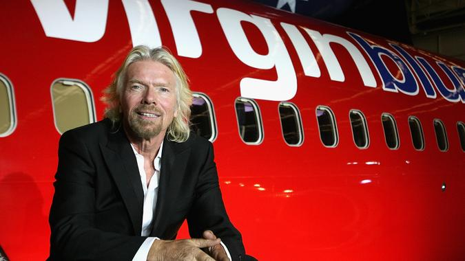 MELBOURNE, AUSTRALIA - SEPTEMBER 12:  Sir Richard Branson celebrates Virgin Blue's 10th Anniversary in Australia at Melbourne Airport on September 12, 2010 in Melbourne, Australia.