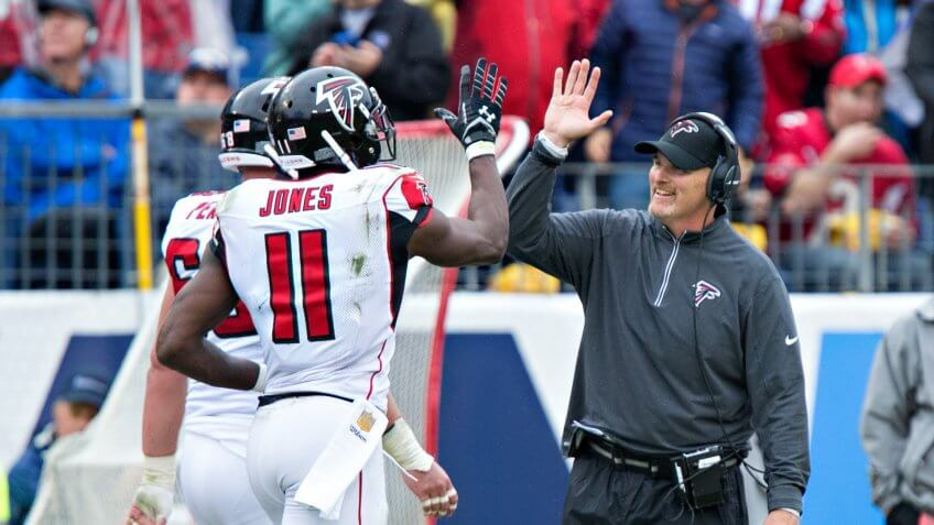NASHVILLE, TN - OCTOBER 25:  Head Coach Dan Quinn celebrates with Julio Jones #11 of the Atlanta Falcons after a touchdown against the Tennessee Titans at Nissan Stadium on October 25, 2015 in Nashville, Tennessee.
