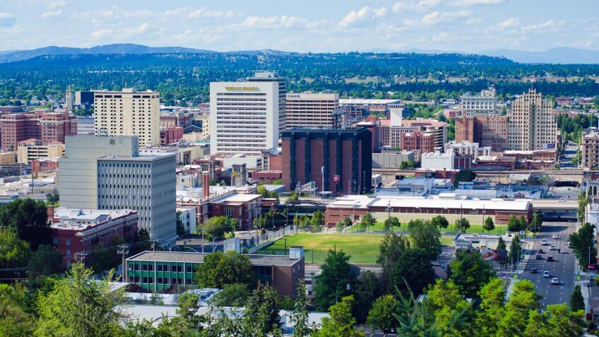 """""""Spokane, United States - July 21, 2012: View of downtown Spokane and several of its office buildings, as seen from an elevated viewpoint along the South Hill."""