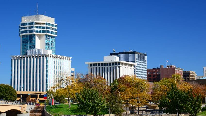 Wichita, Kansas downtown skyline during Autumn, with Autumn trees in the foreground.