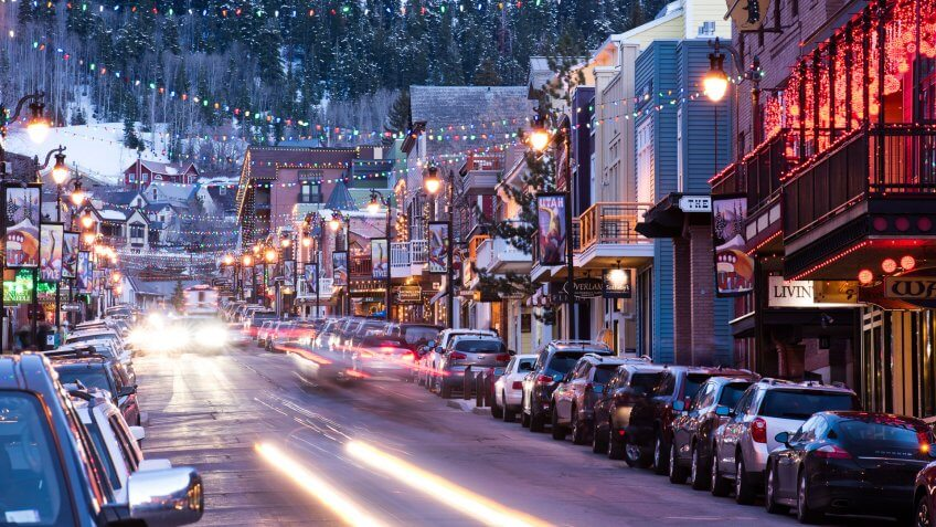 Long exposure of cars driving down Main St.