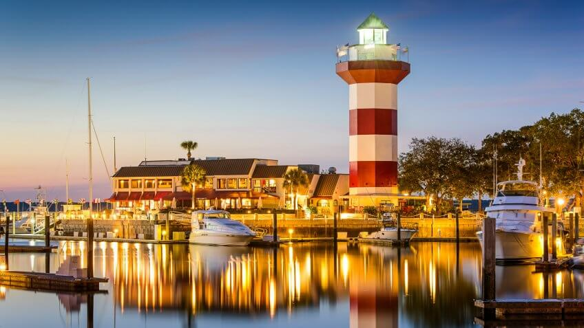 Hilton Head, South Carolina, USA lighthouse on the coast at twilight.