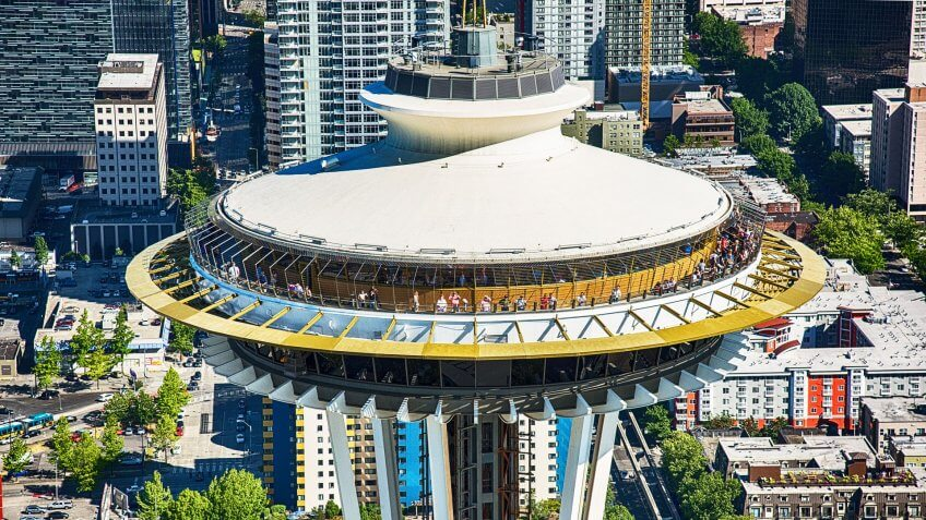 Seattle, United States - June 6, 2016: Tourists crowded atop the observation deck of the Space Needle on a warm summer afternoon.