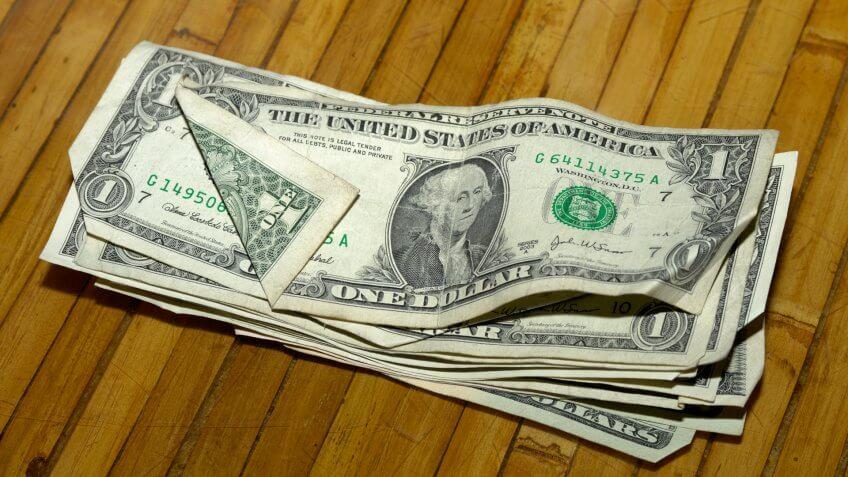 Dollar Bills on Restaurant Table.
