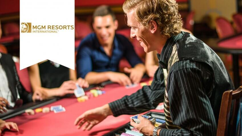 Friends playing at poker at Casino.