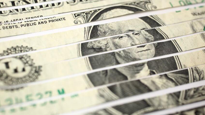 Close-up of shredded US one dollar bill.