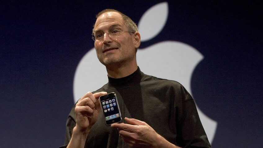 SAN FRANCISCO, CA - JANUARY 9: Apple CEO Steve Jobs holds up the new iPhone that was introduced at Macworld on January 9, 2007 in San Francisco, California.