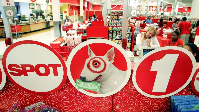 ALBANY, CA - MAY 15:  Customers check out at cash registers in a Target store May 15, 2006 in Albany, California.