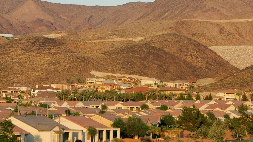 HENDERSON, NV - JUNE 30:  Custom homes are being built on hillsides at the MacDonald Highlands community on the southern end of Henderson, on June 30, 2005 in Henderson, Nevada.
