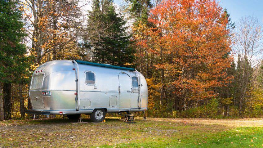 Retro style stainless steel caravan in American outdoors.