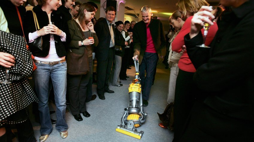 LONDON - MARCH 14: Inventor James Dyson demonstrates his latest hoovering invention on March 14, 2005 in London.