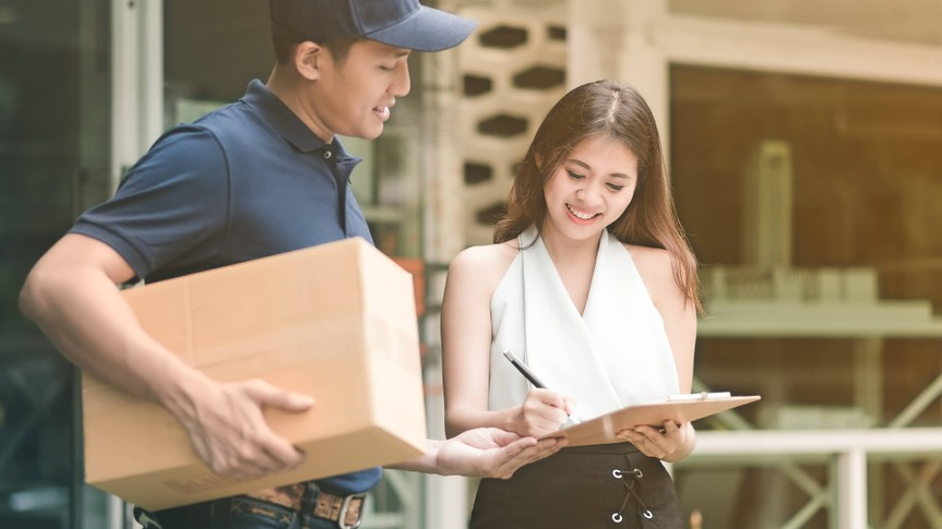 woman receiving free shipping package