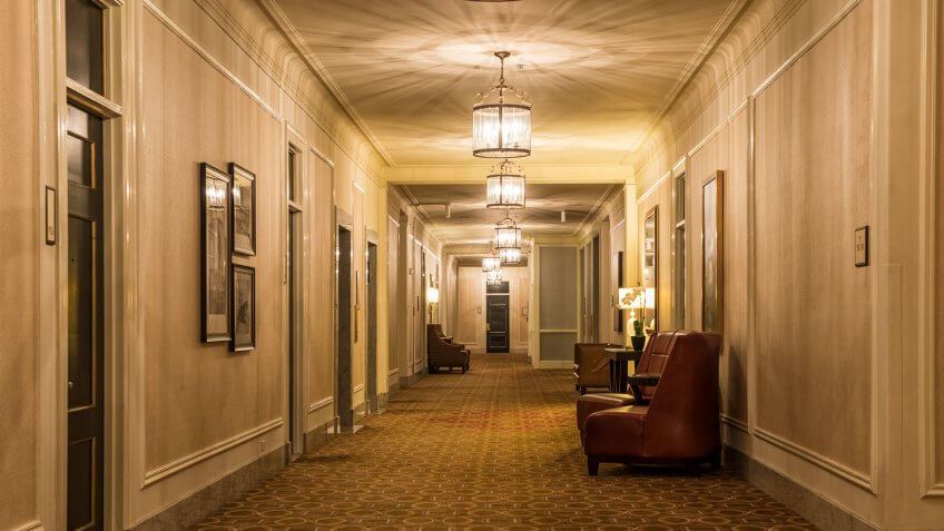 a hotel hallway / gets from the elevator / over to your room.
