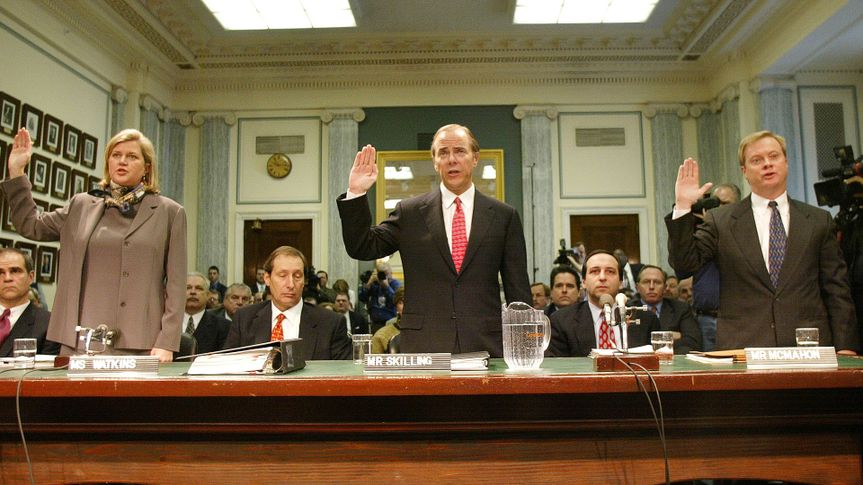 WASHINGTON - FEBRUARY 26:  (FILE PHOTO)  (L-R)  Enron's Vice President of corporate development Sherron Watkins, Former President and CEO of Enron Corporation Jeffrey Skilling and President and Chief Operating Officer of the Enron Corporation Jeffrey McMahon raise their right hand as they are sworn in before the Senate Committee on Commerce Science and Transportation February 26, 2002 in Washington, DC.