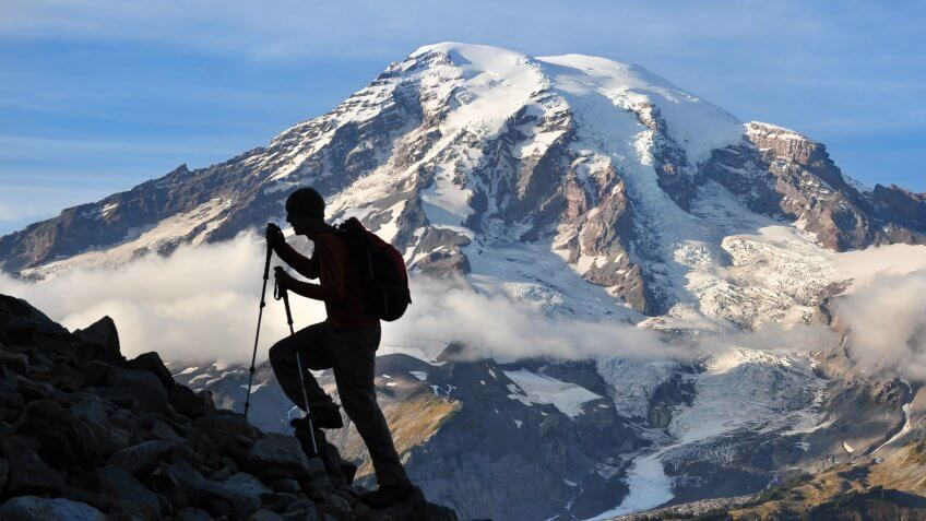 """A hiker ascends a slope in the Tatoosh Range in Mt."
