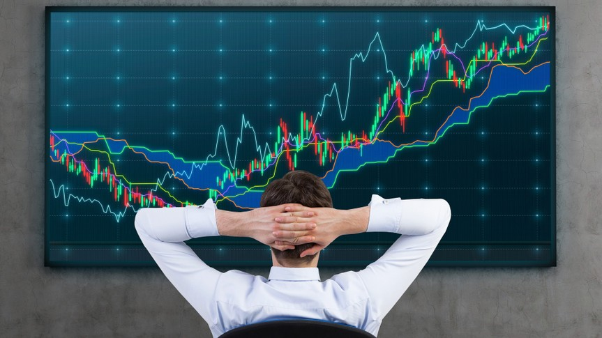 Relaxing businessman and forex screen.