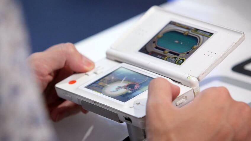 CHIBA, JAPAN - SEPTEMBER 16:  A visitor plays Namco Bandai Games Inc.