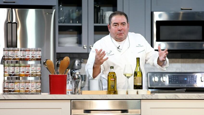 NEW YORK, NY - OCTOBER 17:  Chef Emeril Lagasse prepares food on stage during the Grand Tasting presented by ShopRite featuring Samsung culinary demonstrations presented by MasterCard - Food Network & Cooking Channel New York City Wine & Food Festival presented by FOOD & WINE at Pier 94 on October 17, 2015 in New York City.