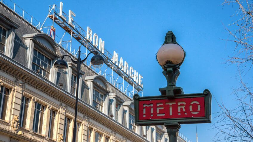 Metro station sign across the Le Bon Marche department store on February 19, 2013.